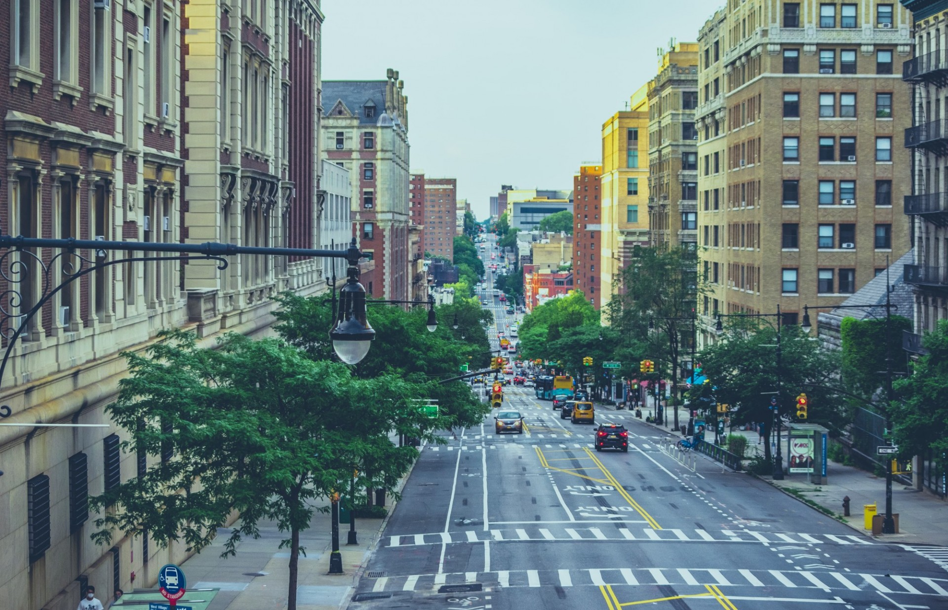 Image of cars driving down Amsterdam Avenue in New York City.